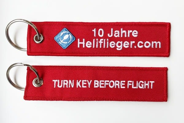 helicopter keychainheliflieger-turn-key-before-flight-red-remove-before-flight